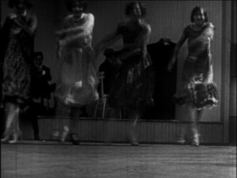 B/W 1926 row of women doing Charleston on outdoor dance floor / newsreel