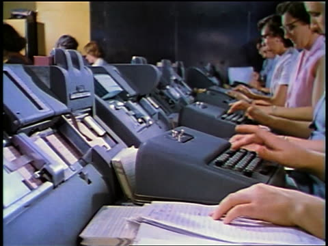 1957 row of women typing on teletypewriters in office - 1957 stock-videos und b-roll-filmmaterial