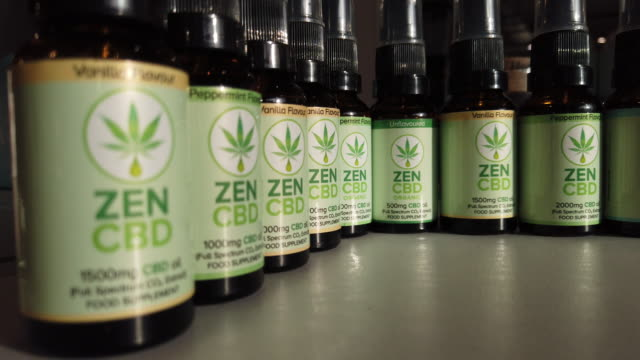 row of zen cbd-based oils are reflected in a cabinet door in a branch of the retail health chain planet organic on february 17, 2020 in london,... - door chain stock videos & royalty-free footage