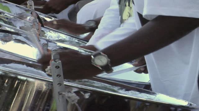 cu row or men playing steel drums/ trinidad - kelly mason videos stock videos & royalty-free footage