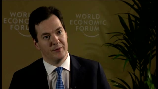 row over bonus for rbs bank chief stephen hester switzerland davos int george osborne mp interview sot i've always said that the levels of pay in... - ロイヤル・バンク・オブ・スコットランド点の映像素材/bロール