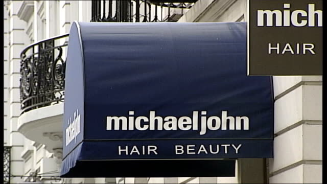 row over cherie blair hairdresser costs mayfair general view of michael john hair dressers michaeljohn sign window of michael john salon with sign... - キャシー・ニューマン点の映像素材/bロール