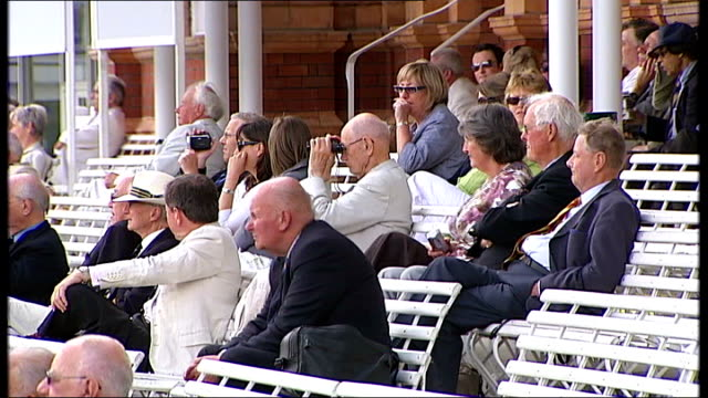 stockvideo's en b-roll-footage met row over future of lords cricket club r17060807 various shots of varsity cricket match spectators watching weather vane - channel 4 news