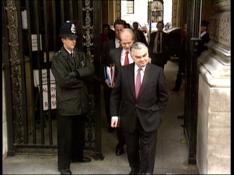 row over norman lamont credit card / wine purchase naf london tms norman lamont mp coming out of gates of treasury and posing for the press tx - credit card purchase stock videos & royalty-free footage
