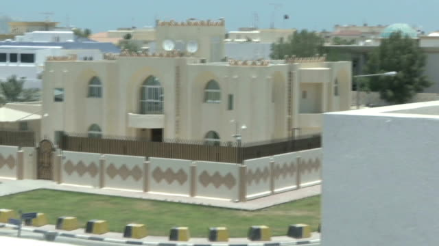 row over opening of taliban office in doha qatar doha ext skyscrapers of west bay pan newlyopened taliban compound qatari diplomatic protection... - taliban stock videos & royalty-free footage