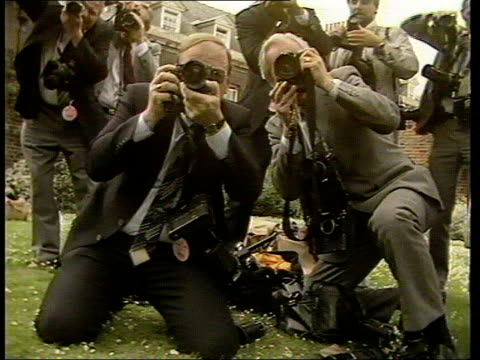 Row over Prince William photographs LIB London Very young Prince William looking into viewfinder of TV camera with his father Prince Charles ZOOM IN...