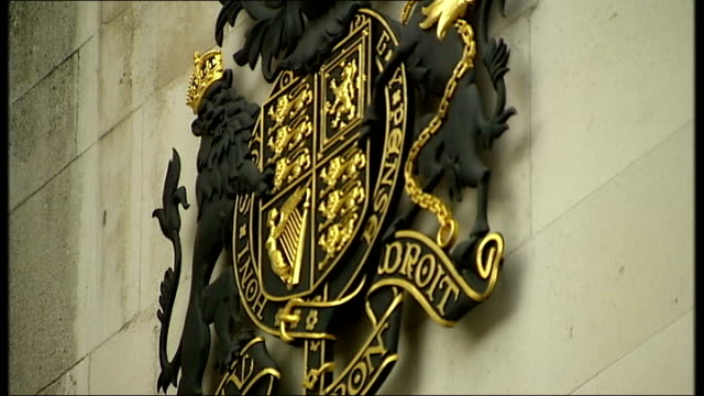 row over treatment of immigants and asylum seekers; london: ian nichol interview sot royal courts of justice: coat of arms on building reporter to... - folded stock videos & royalty-free footage