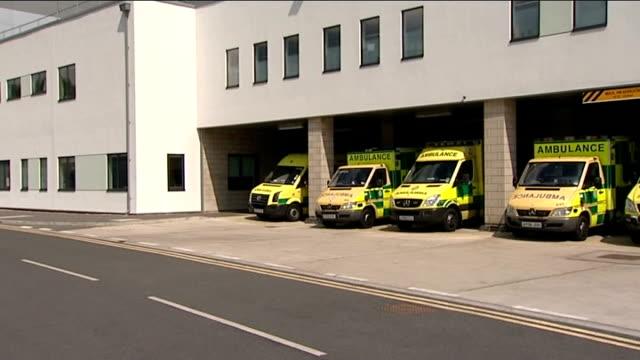 rowan atkinson departs hospital in ambulance following car crash; england: cambridgeshire: peterborough city hospital: ext gvs - ambulances reversing... - rowan atkinson stock videos & royalty-free footage
