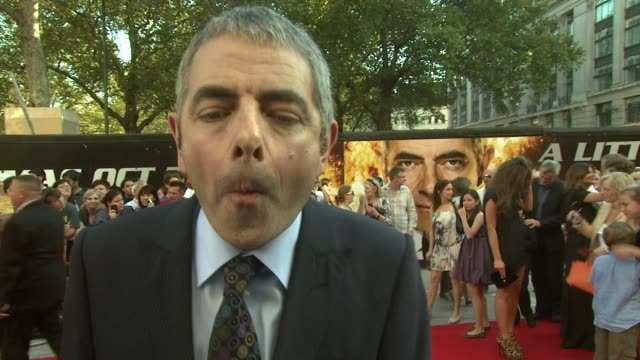 rowan atkinson on how different mr bean and johnny english are at the johnny english reborn uk premiere at london england. - rowan atkinson stock videos & royalty-free footage