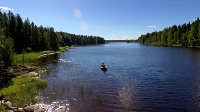 rowboat with people - finlandia video stock e b–roll