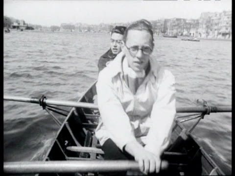 stockvideo's en b-roll-footage met rowboats sailing on amstel and in canals / amsterdam noordholland netherlands - noord holland