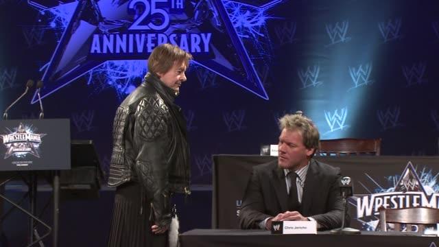 'Rowdy' Roddy Piper and Chris Jericho at the WrestleMania 25th Anniversary Press Conference at New York NY