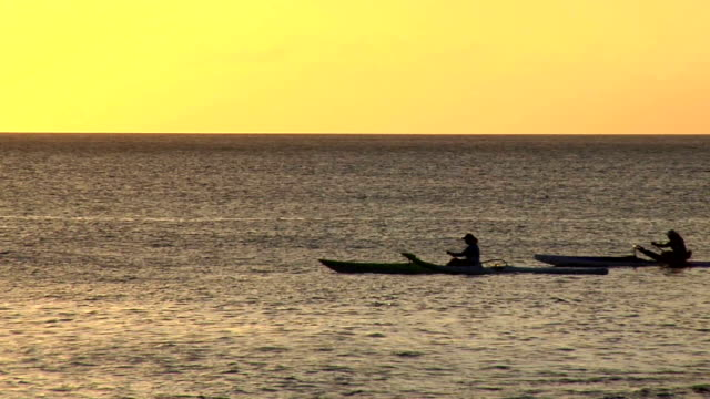 hd: rowing across the sea - distant stock videos & royalty-free footage