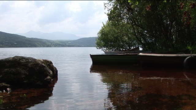 ms, rowing boat anchored at lake shore, kerry county, ireland - anchored stock videos & royalty-free footage