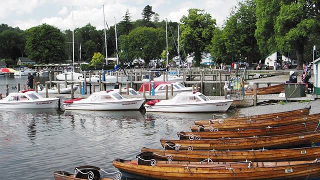 rowing boats and hire boats at waterhead in ambleside on lake windermere, lake district, uk. - tourism stock videos & royalty-free footage