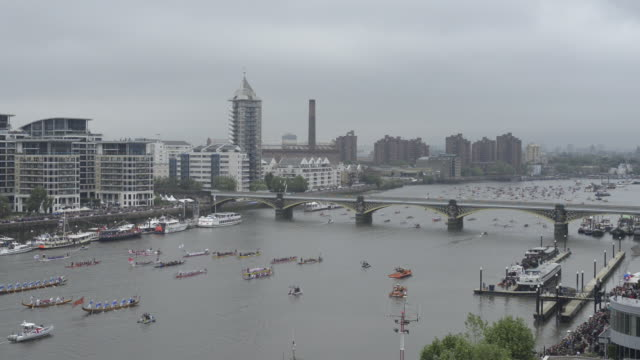rowing boats in the diamond jubilee flotilla on the river thames - flotilla stock videos & royalty-free footage