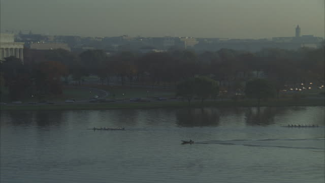 aerial, rowing boats on potomac river, national mall in background,  arlington, virginia, usa - arlington virginia video stock e b–roll