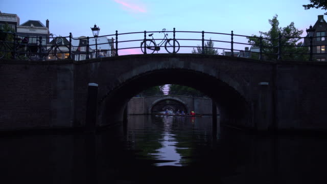 rowing crew on canal - boat point of view stock videos & royalty-free footage