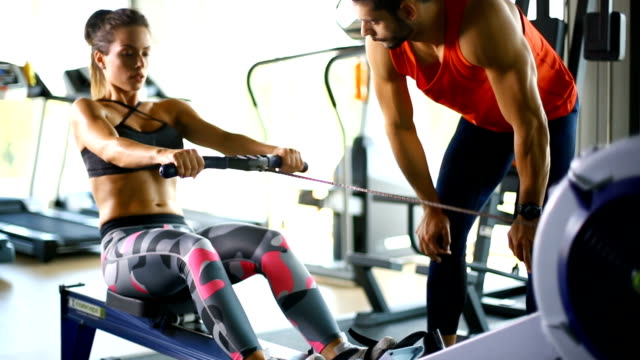rowing exercise at the gym - effort stock videos & royalty-free footage
