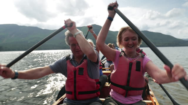 rowing in the lakes with friends - life jacket stock videos & royalty-free footage