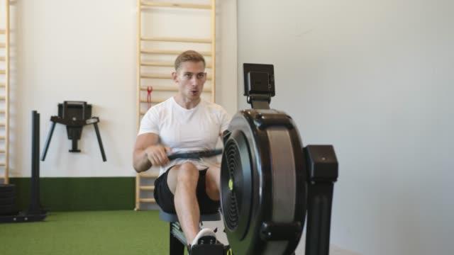 rowing machine cardio - shirtless stock videos & royalty-free footage
