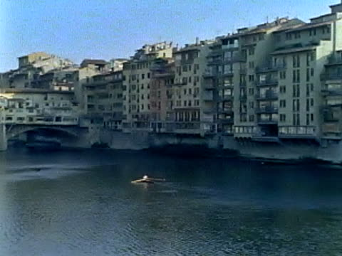 rowing on the arno river by ponte vecchio - florence stock videos and b-roll footage