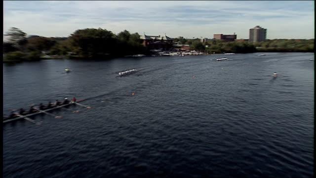 rowing teams on boats in head of the charles regatta in boston - チャールズ川点の映像素材/bロール