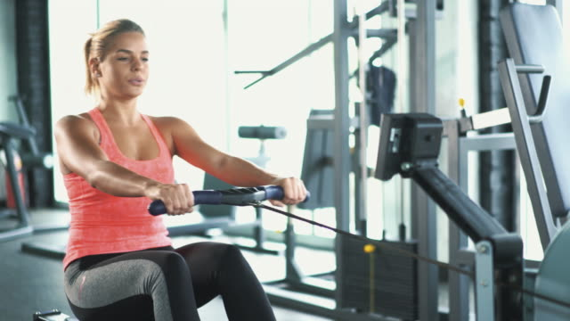 rowing workout at gym. - gym stock videos & royalty-free footage