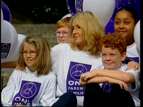 j k rowling donates money to single parents family charity england london rowling sitting with children for photocall on taking up the role as... - j.k. rowling stock videos and b-roll footage