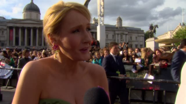 rowling on the support of bringing her vision to life how she started at the harry potter and the deathly hallows part two world premiere at london... - j.k. rowling stock videos and b-roll footage