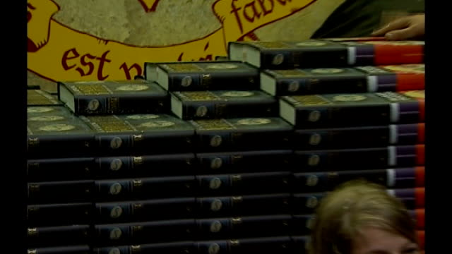 jk rowling to set up her own harry potter publishing website date launch of harry potter books in bookstore and young fans reading dressed in costume - harry potter stock videos & royalty-free footage
