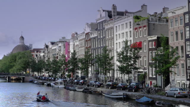 rows of 17th century style houses line the street in front of amsterdam's central canals. - 17th century style stock videos & royalty-free footage
