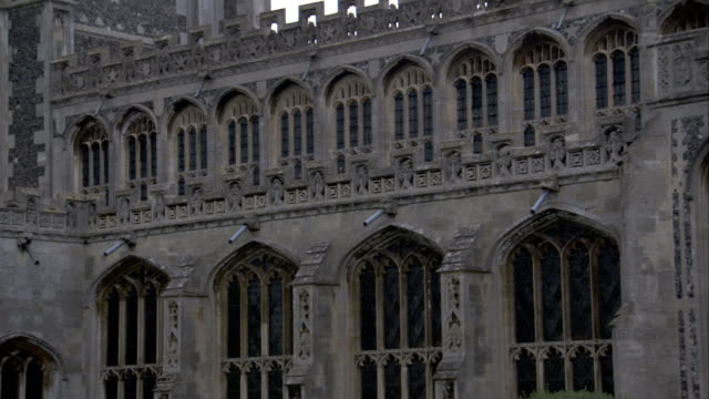 rows of arched windows on the church of st peter and st paul in lavenham. available in hd. - lavenham stock-videos und b-roll-filmmaterial