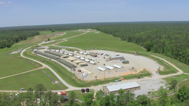 ws aerial rows of army tents at camp shelby military post / mississippi, united states - military base stock videos & royalty-free footage