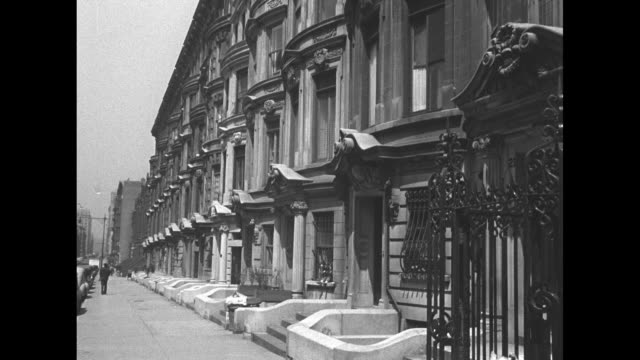 rows of brownstone buildings with wrought iron railings and parked cars / note: exact year not known - railings stock videos & royalty-free footage