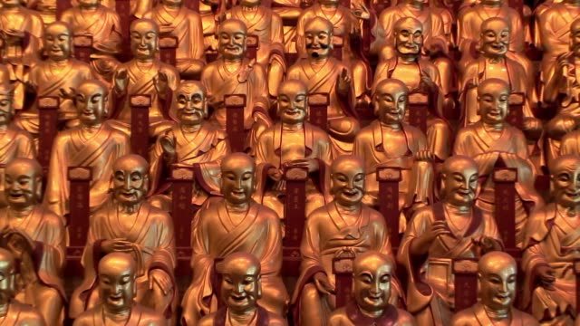 Rows of Buddha statues line a temple in Shanghai.