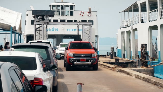 rows of cars get off from a ferry in koh chang - ferry deck stock videos & royalty-free footage