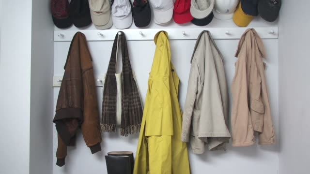 CU Rows of coats and caps hanging from hooks, Scarborough, New York, USA