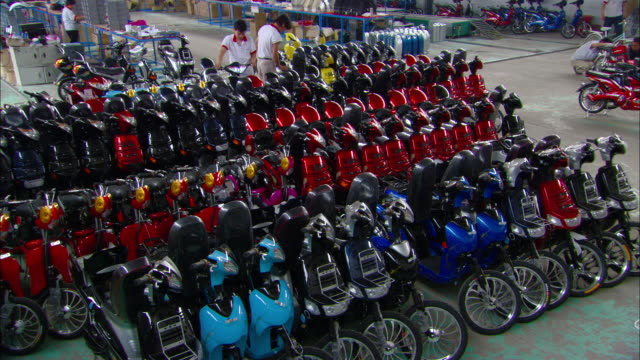 ws ha tu rows of colorful electric bicycles on floor of aihu electric bicycle factory, tianjin, tianjin, china - chinese culture stock videos & royalty-free footage