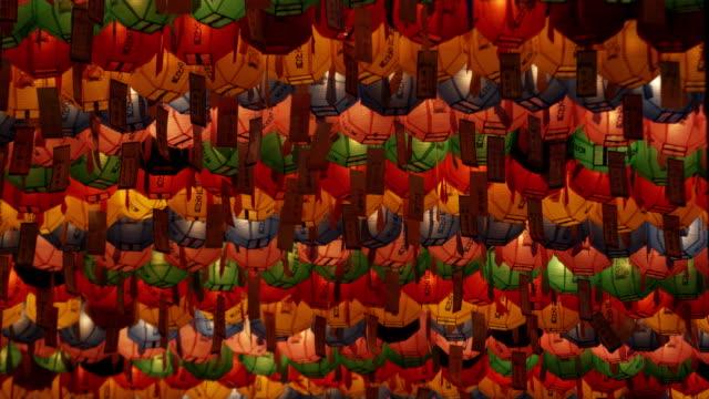 cu la rows of colorful paper lanterns with prayers at jogyesa temple, buddha's birthday, seoul, south korea - buddha's birthday stock videos and b-roll footage