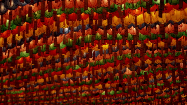 cu la focusing rows of colorful paper lanterns with prayers at jogyesa temple, buddha's birthday, seoul, south korea - buddha's birthday stock videos and b-roll footage