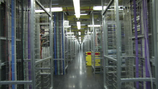rows of computers fill a giant server room. - server room stock videos & royalty-free footage