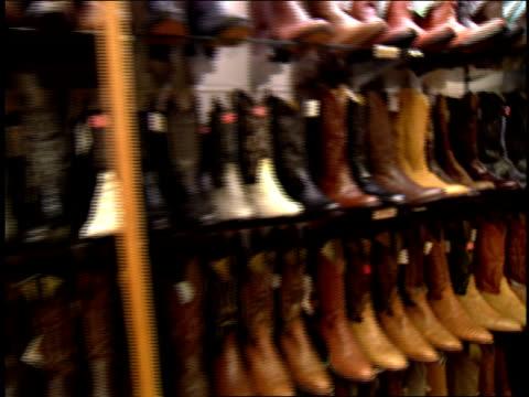 stockvideo's en b-roll-footage met rows of cowboy boots in casper, wyoming - agrarisch beroep
