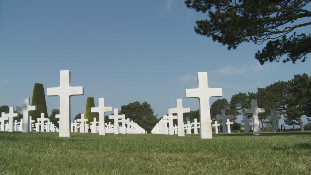 ms la rows of crosses at american cemetery at omaha beach, colleville-sur-mer, normandy, france - omaha beach stock videos and b-roll footage