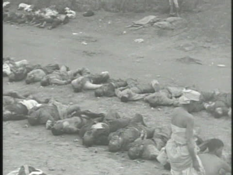 rows of deceased south koreans lying on in line on dirt road other koreans cleaning counting bodies people observing bodies casualties kia killed in... - korean war stock videos & royalty-free footage