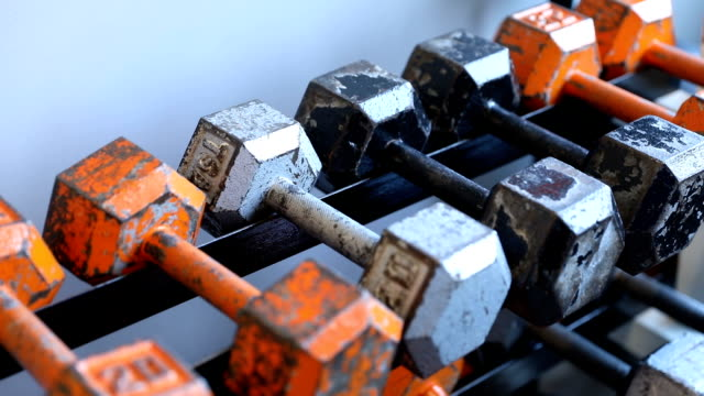 rows of dumbbells in a fitness gym - rack stock videos & royalty-free footage