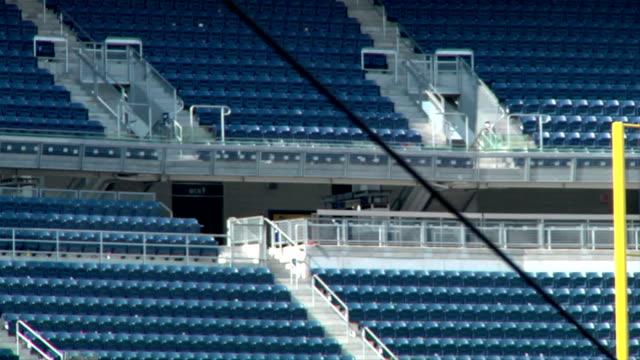 Rows of empty blue stadium seats in Yankee Stadium ballpark NYC MLB Bronx Bombers