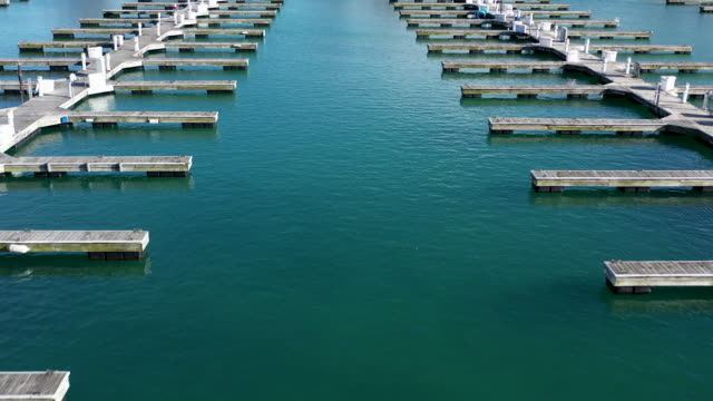 rows of empty docks at marina low fly over - lake michigan stock videos & royalty-free footage