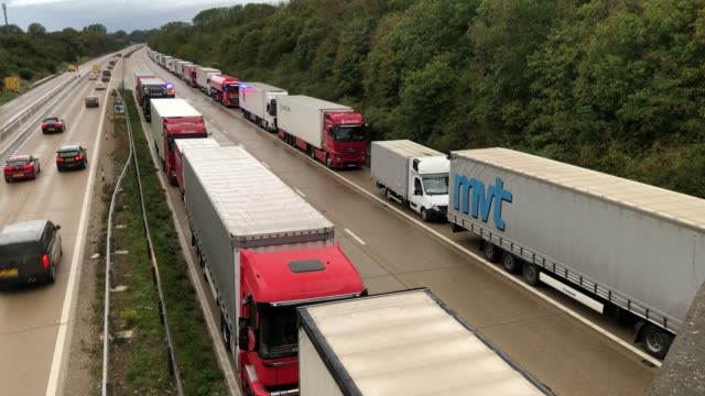 rows of heavy goods vehicles and cargo lorries are seen queued along the m20 motorway as part of the operation stack traffic control plan, on... - air traffic control tower stock videos & royalty-free footage