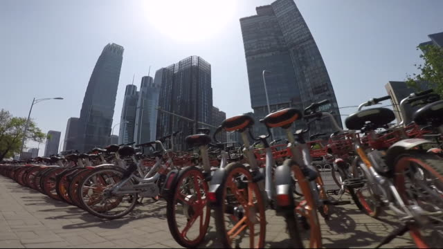 rows of hire bikes in beijing china - in a row stock videos & royalty-free footage